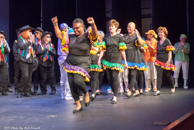 group of women line dancing on stage